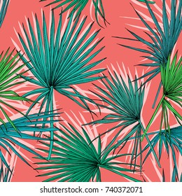 Seamless pattern with image of a green Fan palm leaves on a coral background. Vector illustration.