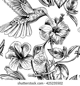 Seamless pattern with image of a Hummingbirds with a Hibiscus flowers. Vector illustration.