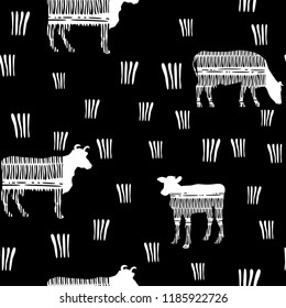 Seamless pattern with the image of silhouettes of cows