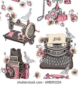 Seamless pattern with image of a vintage Typewriter, Sewing machine, Camera Box, Telephone, Cherry Flowers and a birds. Vector illustration.