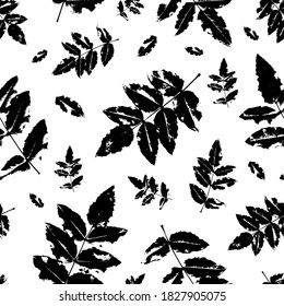 Seamless pattern with imprints of the leaves of trees. Endless texture for the design of nature, fabric, decorative background. Vector stock illustration.