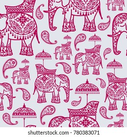 Seamless pattern with indian wedding elephant and paisley patterned on background color.