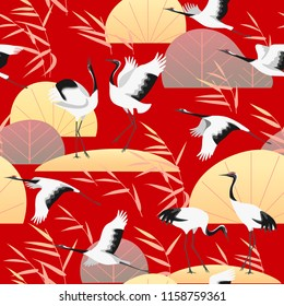 Seamless pattern with Japanese cranes, golden reed and plants on red background. Endless texture decoration in oriental style with simple elements of autumn plant and birds. Vector flat illustration.