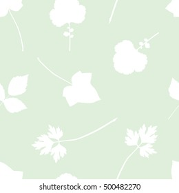 Seamless pattern with leaves silhouette. Background with leaves of herbs, ivy, rose.