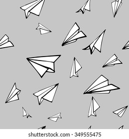 Seamless pattern with linear paper planes. Hand drawn background. Adult colored book.