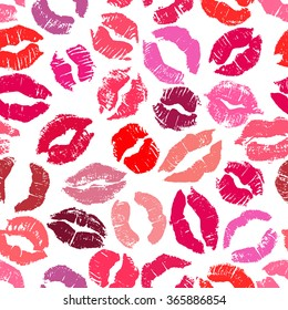 Seamless pattern with lipstick kisses. Imprints of colorful lipstick of red and pink shades isolated on a white background. Can be used for fabric print, wrapping paper or romantic greeting card