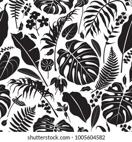 Seamless pattern made with black silhouettes of tropical leaves and flowers on white background. Tropic folage texture.Vector flat illustration.