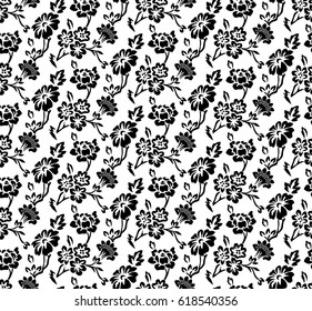 Seamless pattern made of stylized black flowers and leaves on white