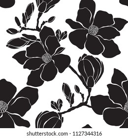 Seamless pattern with magnolia branches on a white background. Monochrome vector illustration. Silhouettes.