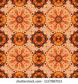 Seamless pattern from mandalas painted in black, orange and brown colors. Vector abstract geometric kaleidoscopic mandala design symbol - symmetric.