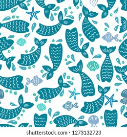 Seamless pattern with mermaid tails, starfishes, jellyfishes, shells. Blue nursery background. Childish design. Perfect for textile, apparel, fabric, wrapping, wallpaper.  Vector illustration.