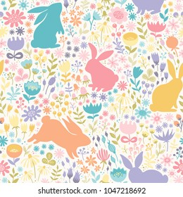 Seamless pattern of multicolored silhouettes of rabbits and wildflowers.Hand-drawn vector texture