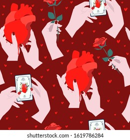 Seamless pattern with mystical elements for Valentines Day. Tarot cards, rose flower and heart in human hand perfect for prints. Editable vector illustration.