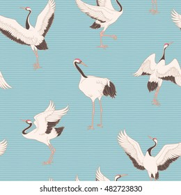 Seamless pattern with ornate dancing japanese cranes. Vector background with traditional asian motives.