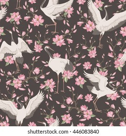 Seamless pattern with ornate magnolia flowers and japanese cranes. Vector floral background with traditional motives.