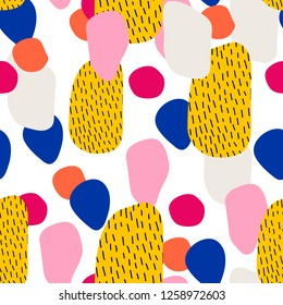 Seamless pattern with overlapping colorful organic shapes