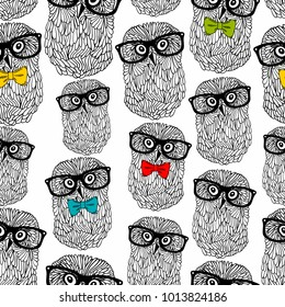 Seamless pattern of owls in hipster style isolated on white background. Endless wallpaper in vector.