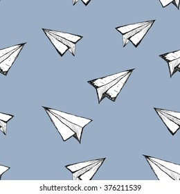 Seamless pattern with a paper airplane on a white background . Drawing by hand . Line drawing. Doodle vector illustration