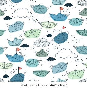 Seamless pattern with paper ships and clouds