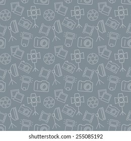 Seamless pattern with photo equipment and symbols. Gray background with line icons for photographic theme. Vector illustration.