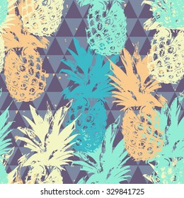 Seamless pattern with pineapple on triangle background in vector
