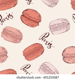 Seamless pattern with pink macaroons and hand writing word Paris, sketch illustration
