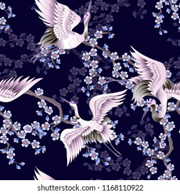 Seamless pattern with pink sakura branches and white Japanese cranes. Vector