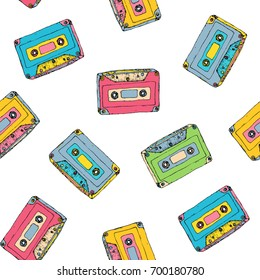 Seamless pattern with plastic cassette, music audio tape. Doodle vector colorful background, retro style.