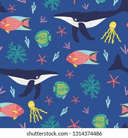 Seamless pattern of playful humback whales, happy tropical fish, octapus, and bright corals in the deep blue ocean. Great for textile print, wallpaper, or packaging. Vector file.