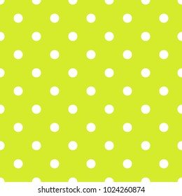 Seamless pattern in polka dot dots white dots on bright yellow green background.