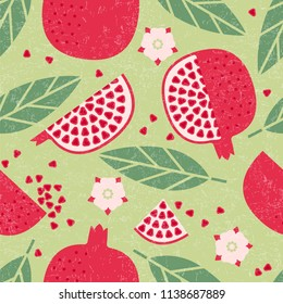 Seamless pattern. Pomegranate juicy fruits, leaves and flowers on shabby background.