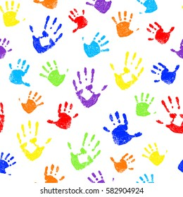 Seamless pattern with rainbow colored family hand prints on white background. Vector illustration.