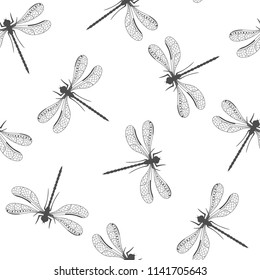 Seamless pattern with randomly arranged black hand painted dragonflies on a white background. Vector illustration.