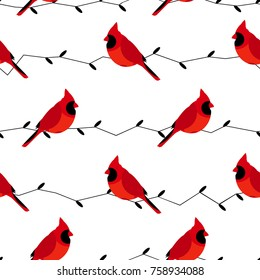Seamless pattern with red cardinal and branches. Flat design style. Vector background.
