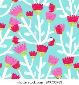 seamless pattern of red and pink tulips on a blue background