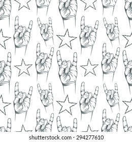Seamless pattern with Rock n Roll sign and a stars. Vector illustration.