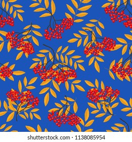 Seamless pattern with rowan berry branches on a blue background. Autumn background with red berries and yellow leaves. It can be used for websites, packing of gifts, fabrics, wallpapers. Vector