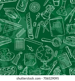 Seamless pattern with school icons.Stationery on a blackboard.Design for lessons, teacher's day, knowledge day.Vector illustration with sketch globe, alarm clock, book, pen, ruler and other stationery