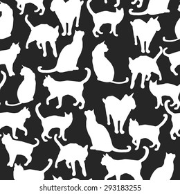 Seamless pattern with silhouettes of cats. Vector illustration