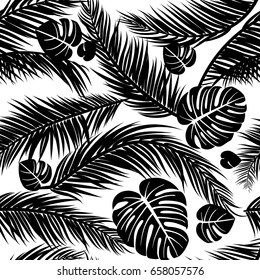Seamless pattern with silhouettes of palm tree leaves in black on white background.Seamless Floral Background. Vector illustration