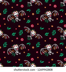 Seamless pattern. The skeleton of an owl with a floral wreath. Cute little owlet. Halloween illustration.