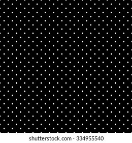 Seamless pattern in a small dot, polka dot style in white on a black background.