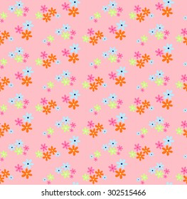 Seamless pattern of small multi-colored flowers looks lovely in sweet style, ideal for children or girls