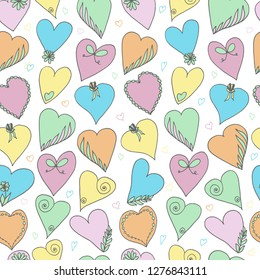 Seamless pattern with soft colored hearts. Hand drawn vector illustration.