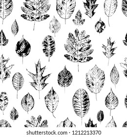 Seamless pattern with stamp leaves. Objects isolated on white. Black and white.Vector. Print for bed linens, fabric, textiles, wallpaper, greeting cards, wrapping paper, gift box