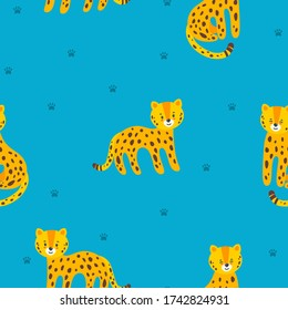 Seamless pattern with standing and sitting leopards and paw prints in blue background. Vector illustration in flat style