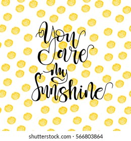 Seamless pattern with  sunshine and hand drawn phrase You are my sunshine . Ornament for Valentine's day. Ink illustration. Isolated on white background.  Modern brush calligraphy.