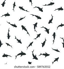 Seamless pattern with swimming sharks shadows