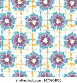 Seamless pattern tie dye shibori flower circle rings. Colorful boho summer background. Vector textile swatch.