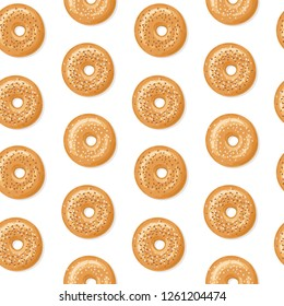 Seamless pattern with top view of fresh bagels, white and brown sesame seeds on top, white background. Delicious breakfast. Vector seamless pattern.